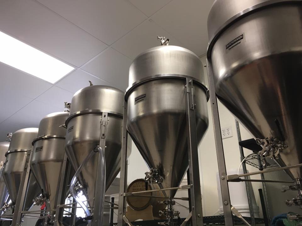 Fermenters inside Roma Restaurant & Brewery's brewhouse // Photo via Roma Restaurant & Brewery's Facebook