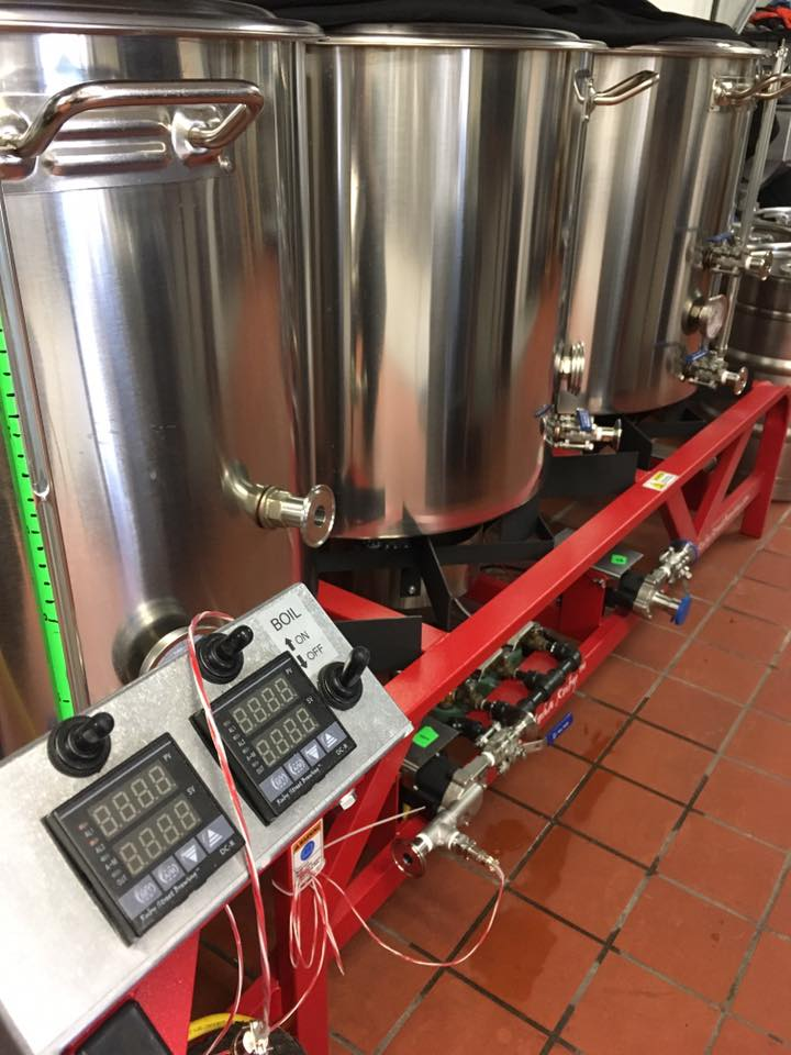 Roma's direct fire one-barrel brewing system // Photo via Roma Restaurant & Brewery's Facebook