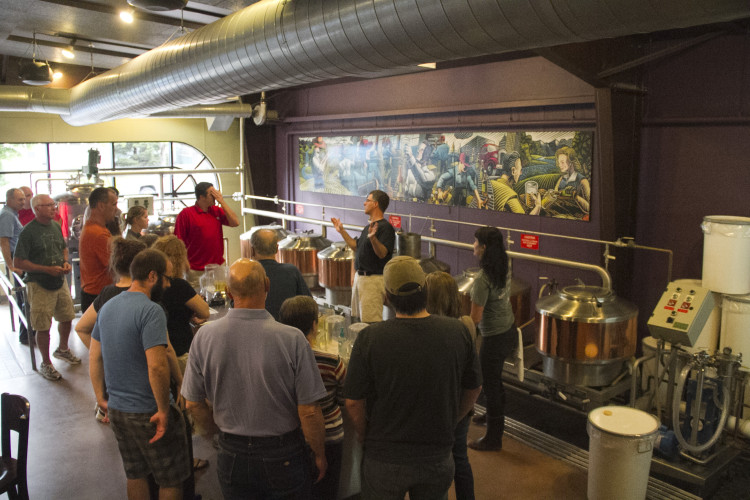 Owner Andy Grage Speaks to the group before brewing // Photo by Brett Spurr