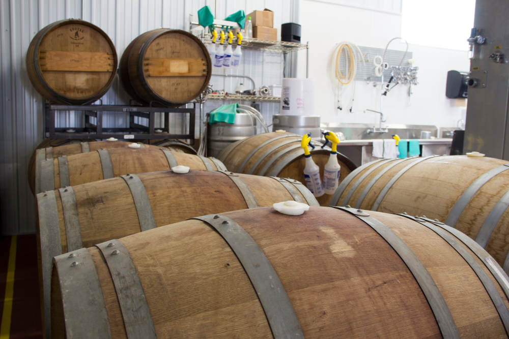 Starting with one oak barrel, Bemidji's barrel program has expanded to 27 red and white wine barrels and 11 whiskey barrels // Photo by Brian Kaufenberg