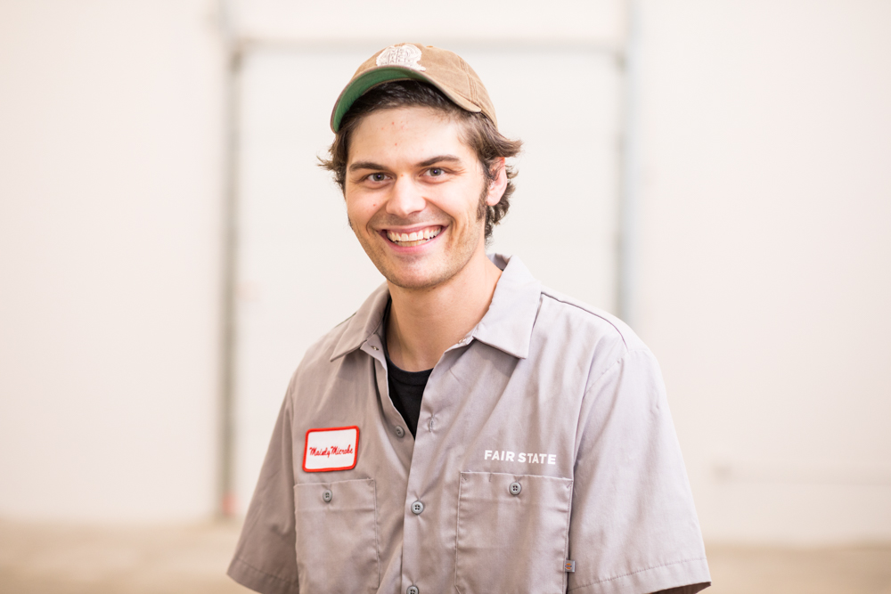 Caleb Levar, brewer at Fair State Brewing Cooperative and co-founder and brewer at Oakhold Farmhouse Brewery // Photo by Tj Turner
