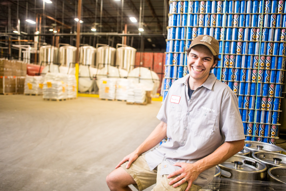 Caleb Levar inside Fair State's new production facility in St. Paul // Photo by Tj Turner