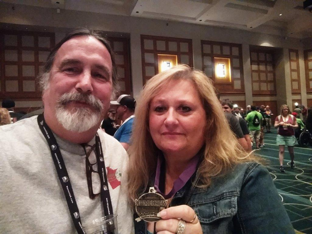 Homebrewer Lori Ertl (R) shows off her gold medal from Homebrew Con 2017 // Photo courtesy of Lori Ertl