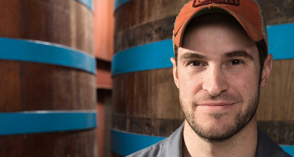 Jace Marti standing in front of the cypress tanks // Photo courtesy August Schell Brewing Co.