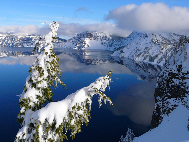 Crater Lake reflecting the clouds over Garfield Peak // Photo courtesy of NPS