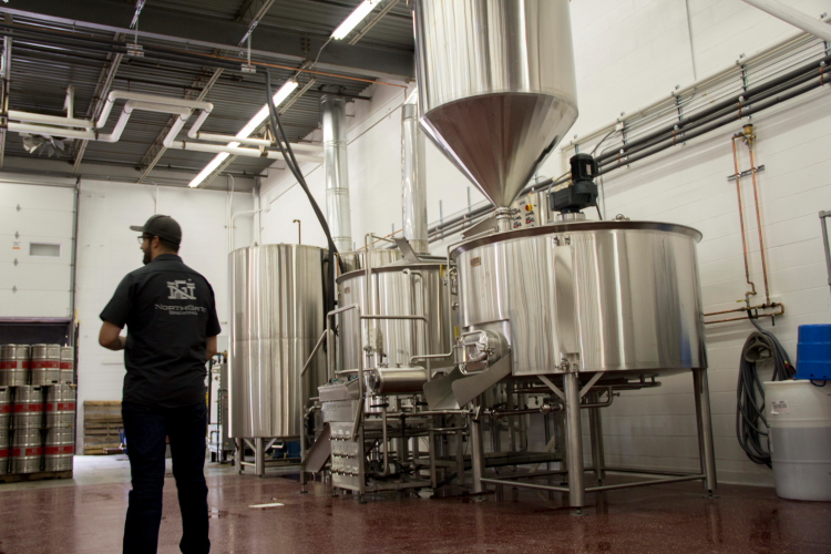 Head Brewer Tuck Carruthers in NorthGate Brewing's New Brewery // Photo by Brian Kaufenberg
