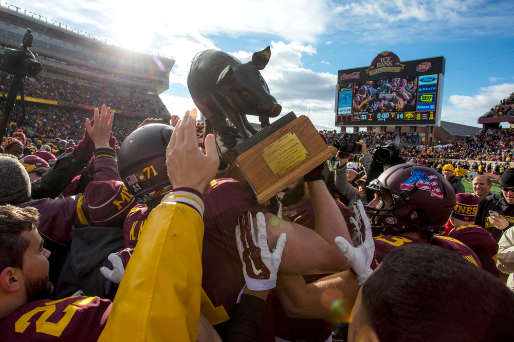 Nov 8, 2014; Minneapolis, MN, USA; Minnesota Golden Gophers hold up Floyd of Rosedale after beating the Iowa Hawkeyes at TCF Bank Stadium. The Gophers won 51-14. Mandatory Credit: Jesse Johnson-USA TODAY Sports