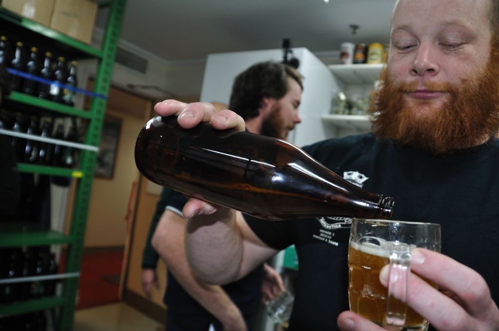 Stu celebrates with a taste of the local brew // Photo by Peter Hargreaves