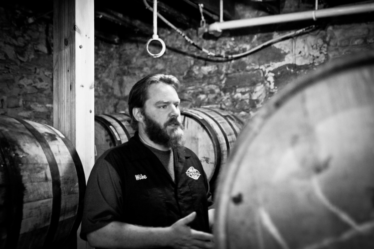 Town Hall Brewery Head Brewer Mike Hoops discusses barrel aging // Photo by Aaron Davidson
