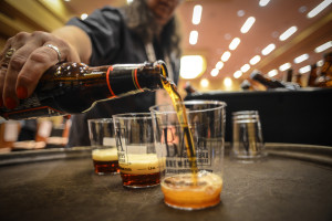 Samples being poured at the GABF // Photo © Brewers Association