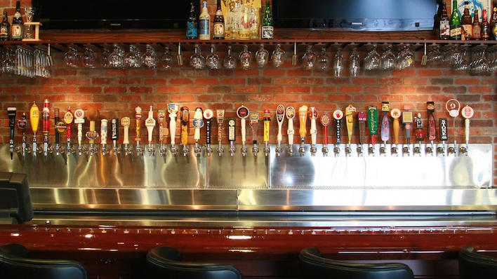 Some of the dozens of taps at World of Beer's Columbus, Ohio, location // Photo via World of Beer