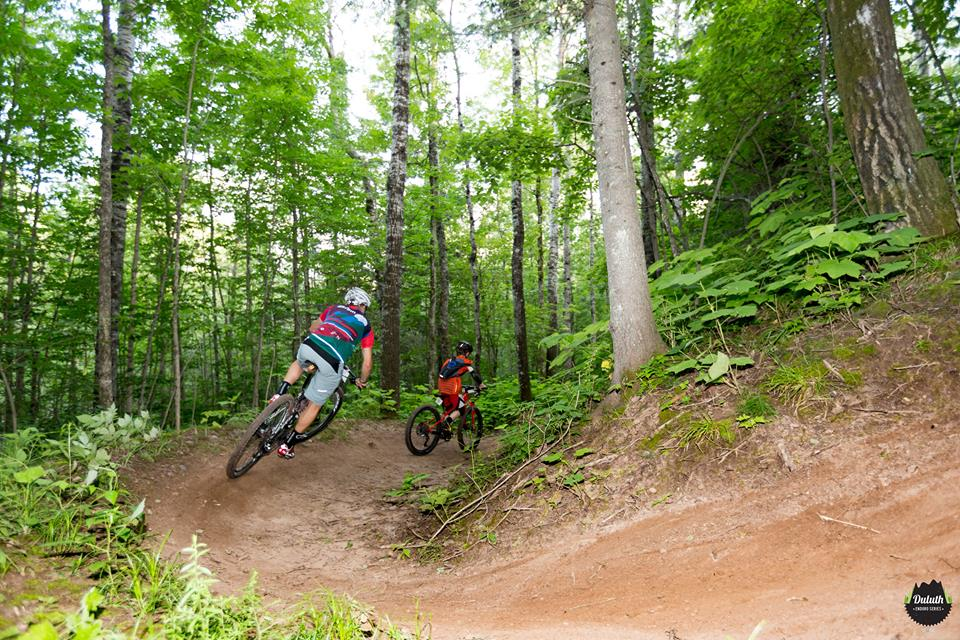 Riders fly through Mission Creek as part of a 2016 Duluth Enduro Series race // Photo courtesy of COGGS