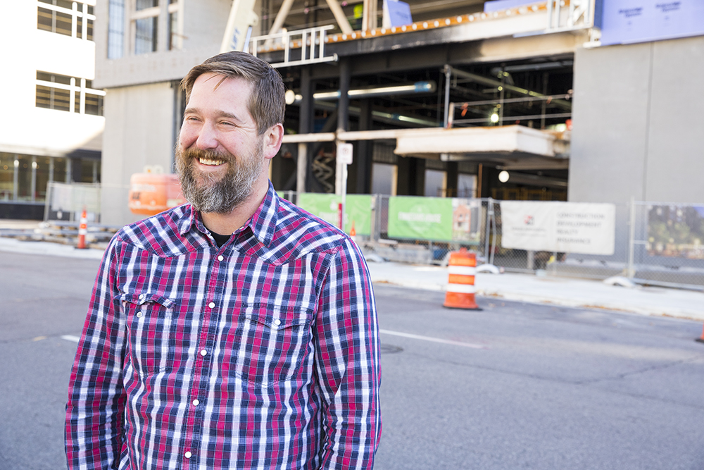 Ryan Mihm, the head brewer at soon to open Finnegan's in Minneapolis' East Town, stands in front of the ongoing construction // Photo by Tj Turner