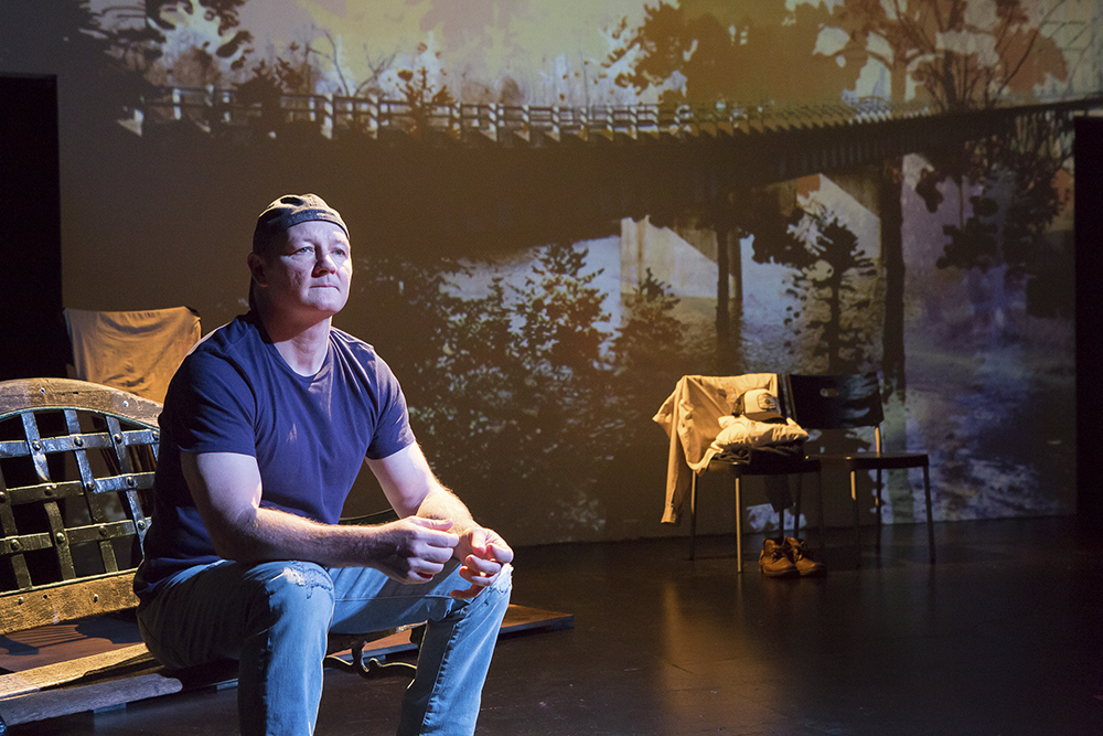 """J. A. Moad II, a former Air Force pilot, performs his play, """"Outside Paducah—The Wars at Home,"""" at the Wild Project Theater in the East Village of New York // Photo by Hunter Canning"""