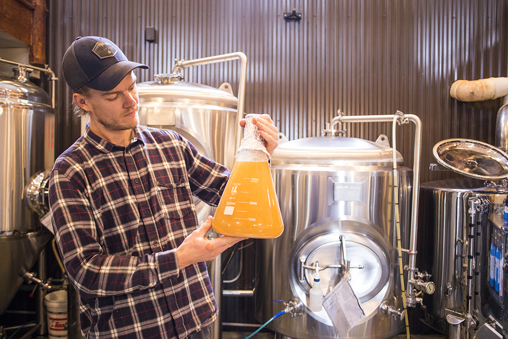 Jeff Vondenkamp with a wild yeast strain on the original Portage brew floor // Photo by Tj Turner