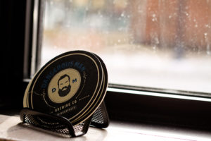 Coasters on the window ledge at Dangerous Man Brewing in NE Minneapolis // Photo by Aaron Davidson