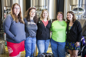 Jennifer Proesel (second from left) helps coordinate events like Big Brew Day // Photo by Brian Kaufenberg