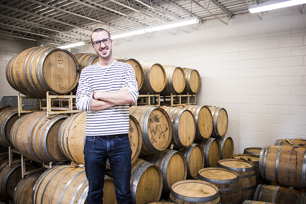 Mat Waddell of Wild Mind Artisan Ales with his experimental oak barrels // Photo by Tj Turner