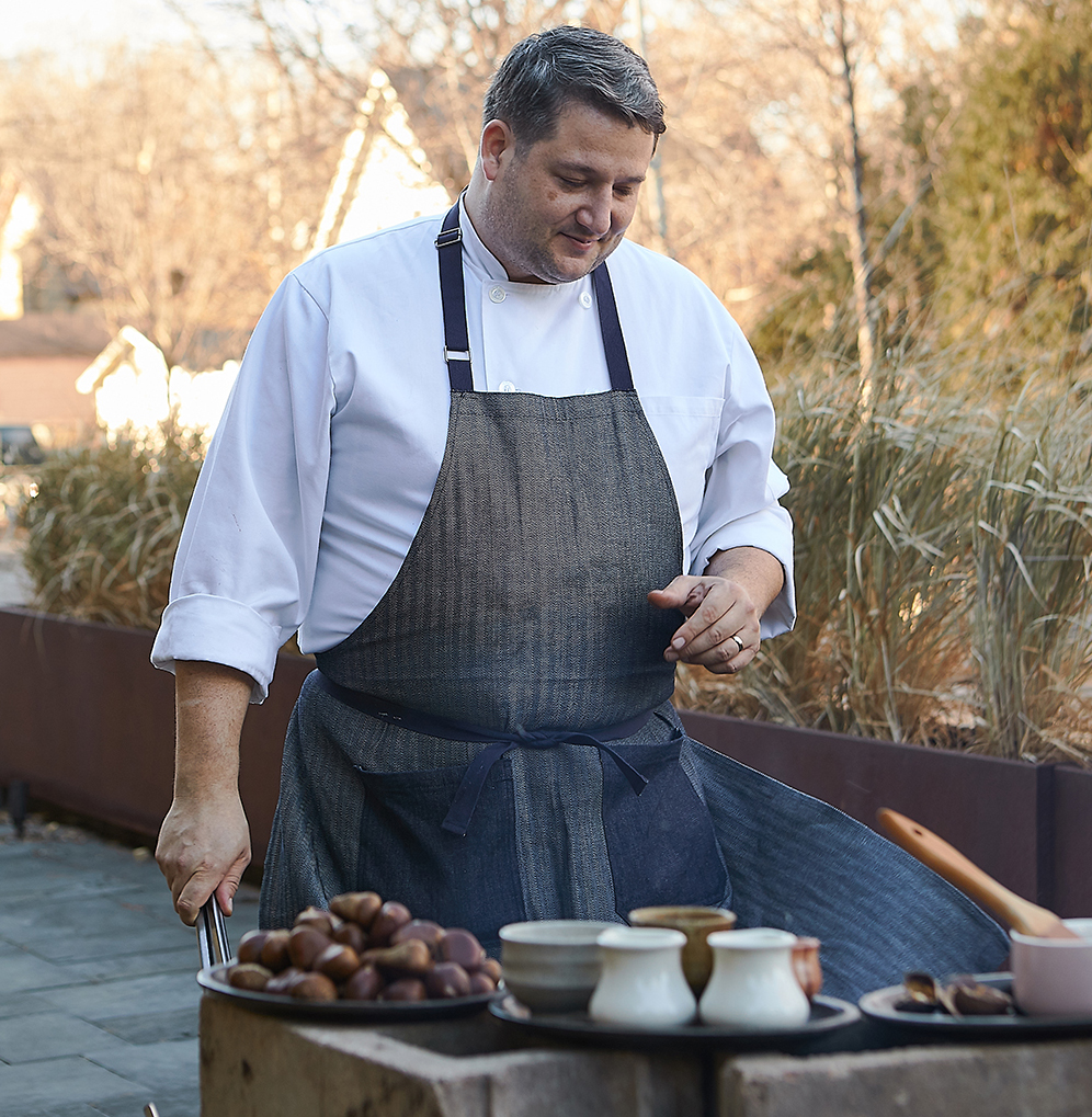 Thomas Beomer roasting chestnuts on an open fire, alongside fingerling potatoes, onions, and the Minnesota delicacy of Turtle // Photo by Wing Ta
