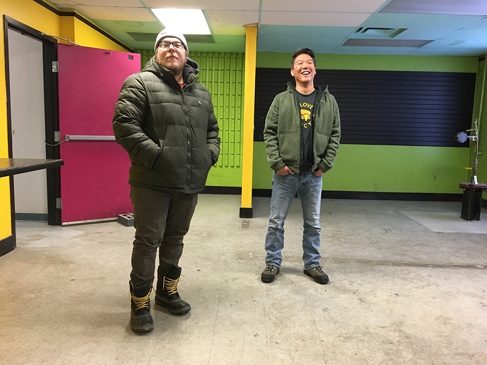 Garth Blomberg, right, and Juno Choi, left, stand in one of the old Harriet Brewing Company rooms, part of Choi and Blomberg's newly acquired building which they hope to build a brewery in // Photo by Joe Alton, The Growler