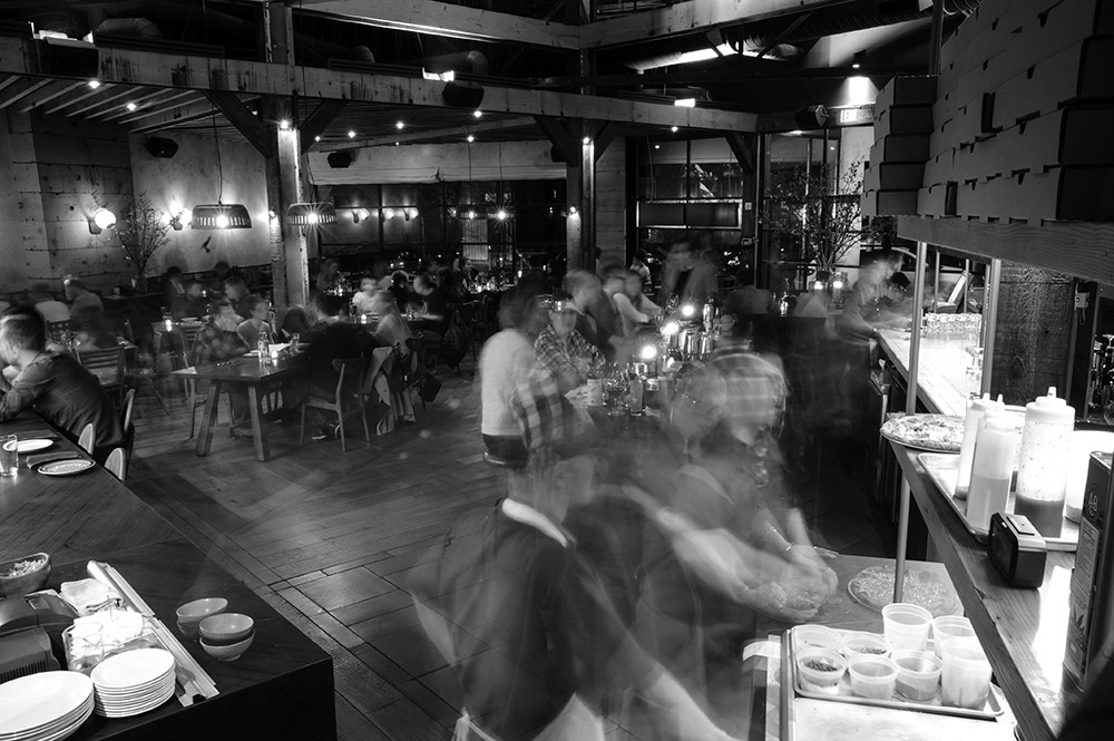 Young Joni employees and patrons during a weekday dinner rush // Photo by Daniel Murphy