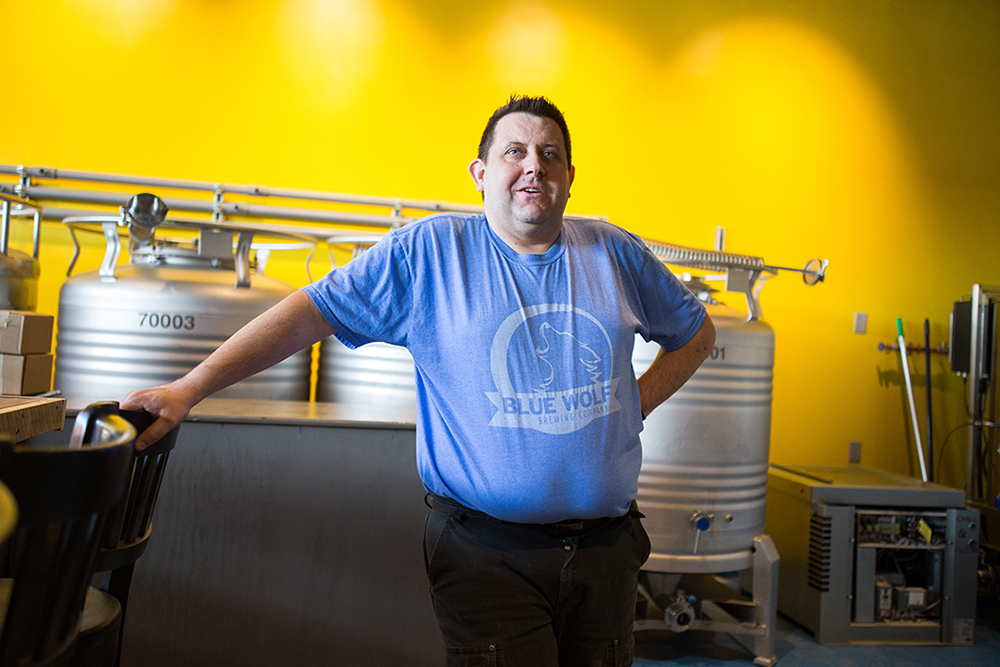 Mike Campbell, head brewer of Blue Wolf Brewing Company, stands in the intimately small 1,700-square-foot taproom in Brooklyn Park, MN // Photo by Aaron Davidson