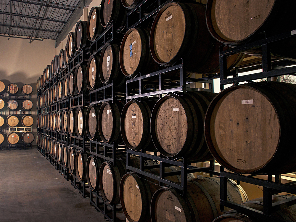 The barrels Indeed Brewing Company uses for their Whiskey Queen Imperial Stout // Photo courtesy Indeed Brewing Company