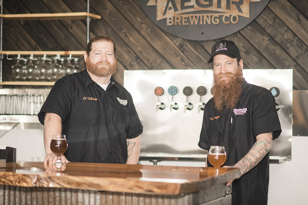 Owner Tim Jones and brewmaster Jeremy Jones of AEGIR Brewing In Elk River, Minnesota, enjoying some of their own beer // Photo by Kayla Lee