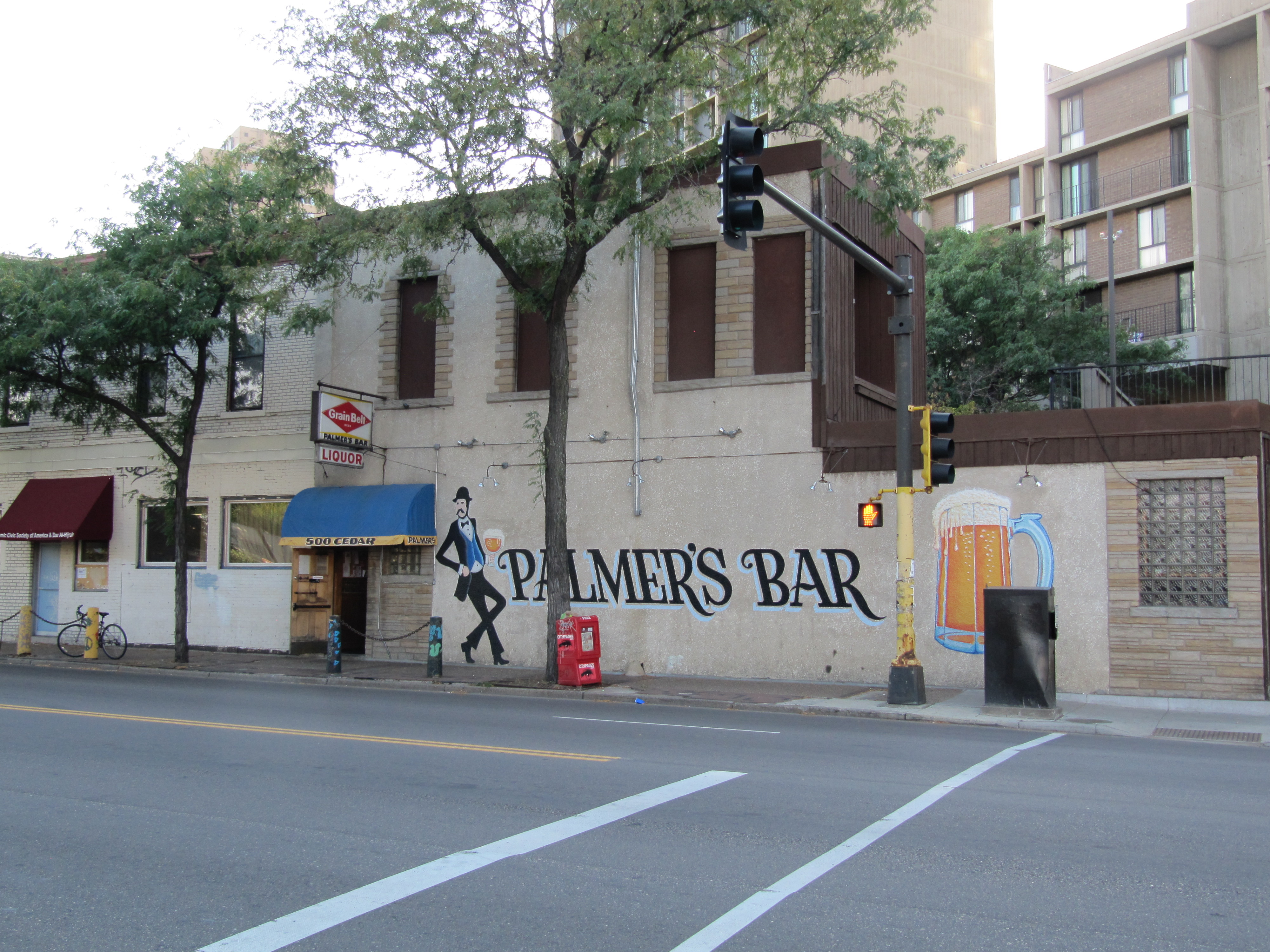 Palmer's Bar and the iconic mural are fixtures in Minneapolis' Cedar-Riverside neighborhood // Photo by Ed Kohler, Flickr