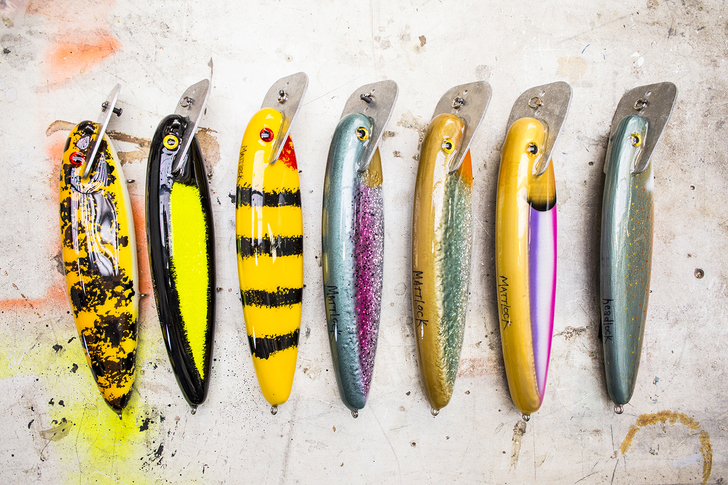 Top: Stacked lure blanks, fresh out of the hot box, waiting to be painted and epoxied. Bottom: A selection of freshly painted and epoxied lures // Photos by Tj Turner