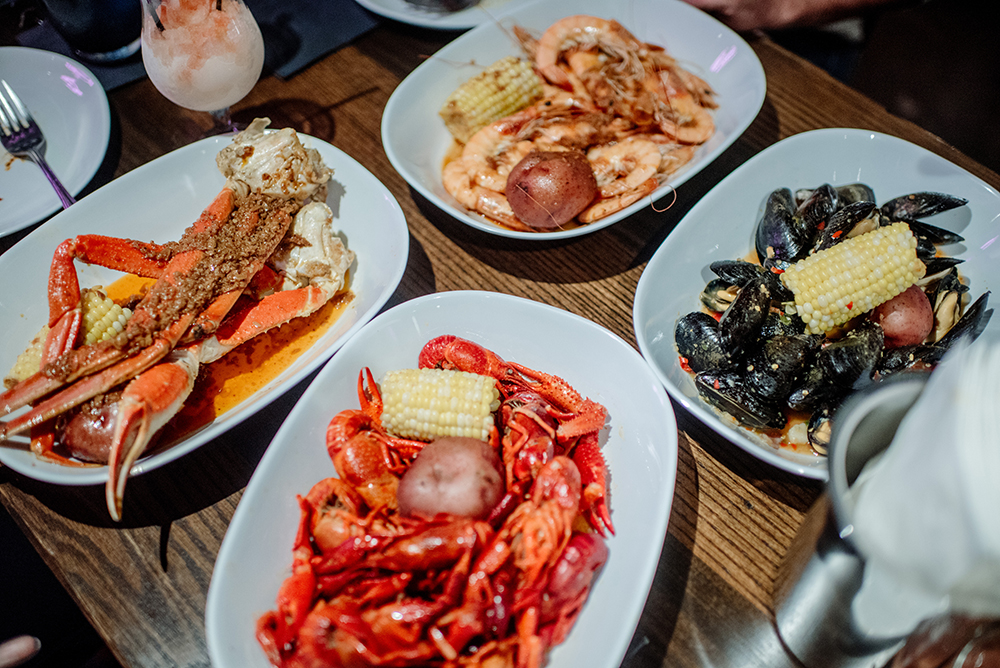 In clockwise order, Crawfish, Snow Crab, Head-on Shrimp, and Mussels // Photo by Becca Dilley
