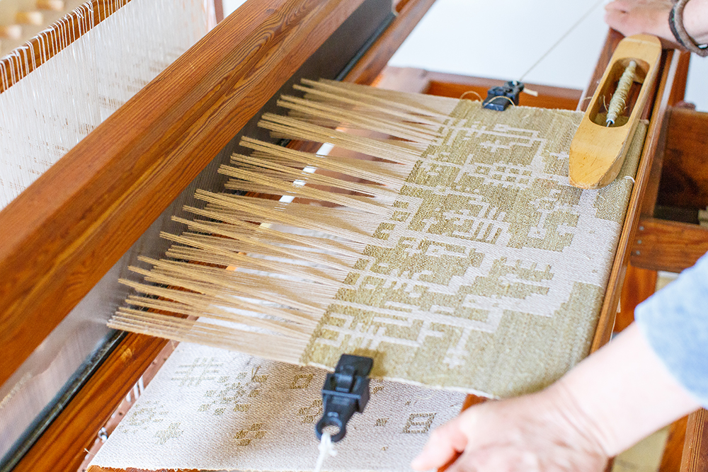Andrea Myklebust works the loom at Black Cat Farmstead, near Lake Pepin, Minnesota // Photo by Barbara O'Brien Photography