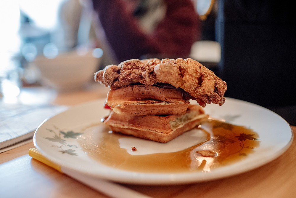 A plate of chicken and waffles at Martha's Daughter // Photo by Becca DIlley