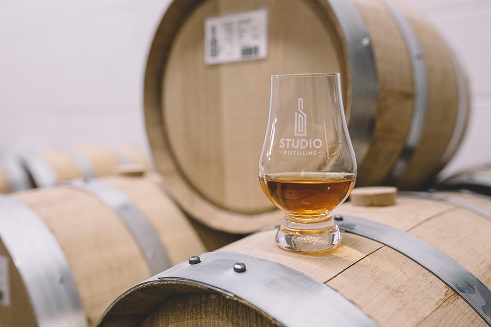 A glass of whiskey at Studio Distilling // Photo by Sam Ziegler