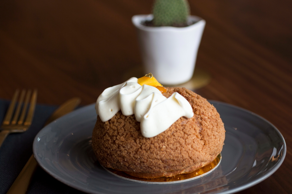 Edward's Dessert Kitchen's Mango Coconut Creme Pie Puff // Photo by Brian Kaufenberg