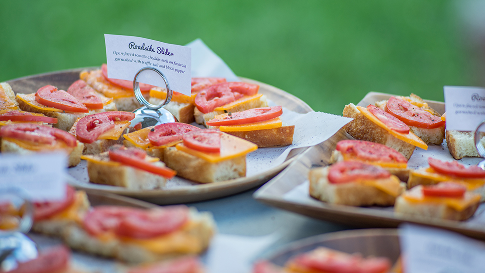 "A ""Roadside Slider"" was offered at the performance of ""Escape from Alcina's Island"". It was an open-faced tomato-cheddar melt on focaccia bread, garnished with truffle salt and black pepper // Photo courtesy Picnic Operetta"