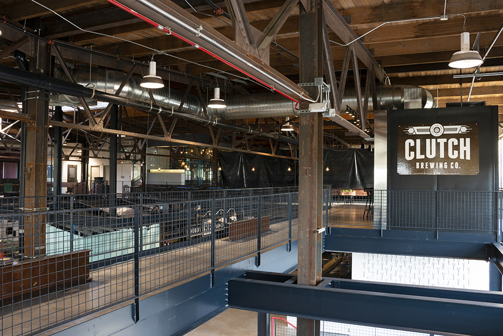 The East entrance of the Keg & Case food hall sits underneath the bar and sign of Clutch Brewing Company, which is on the upper level of the old Schmidt Brewery // Photo by Aaron Job