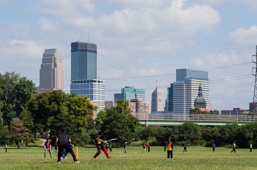A cricket match being played in Boom Island Park in Minneapolis, Minnesota // Photo by Harrison Barden