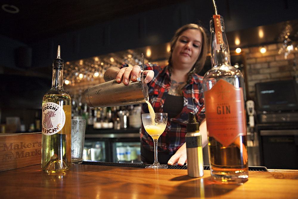 """Olivia Engel, a bartender at Nightingale, pouring the """"God Save The Queen"""" cocktail // Photo by Katie Cannon"""