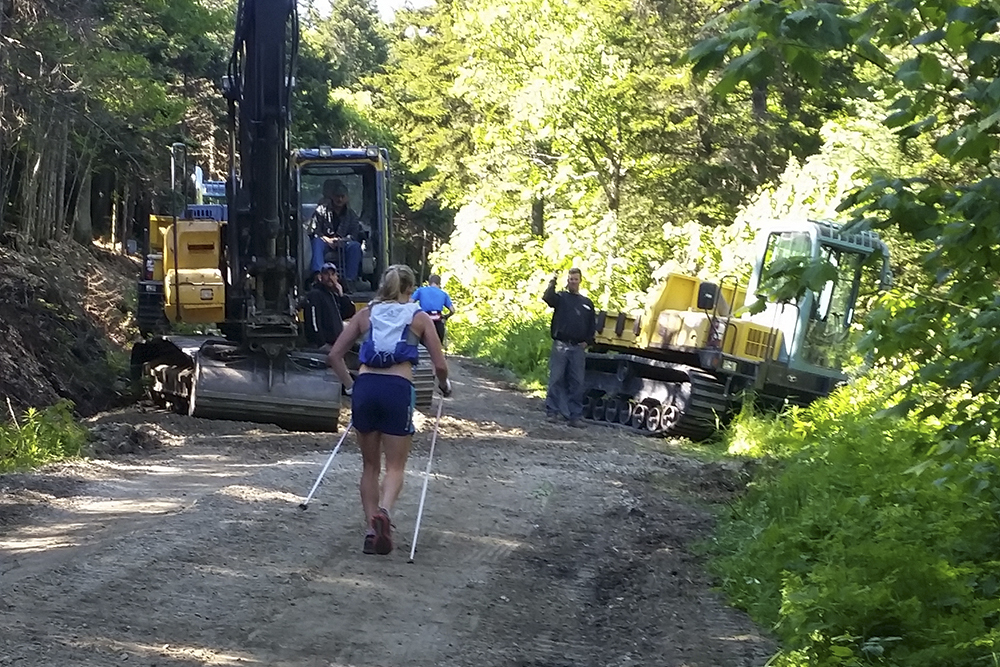 Road construction workers pause to clear a path for Jessie Diggins // Photo by Todd Smith