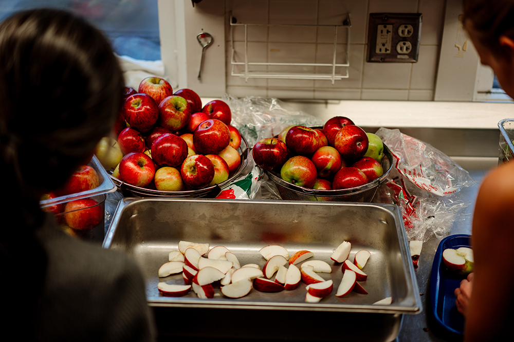 Two of the attendees slicing apples // Photo by Becca Dilley