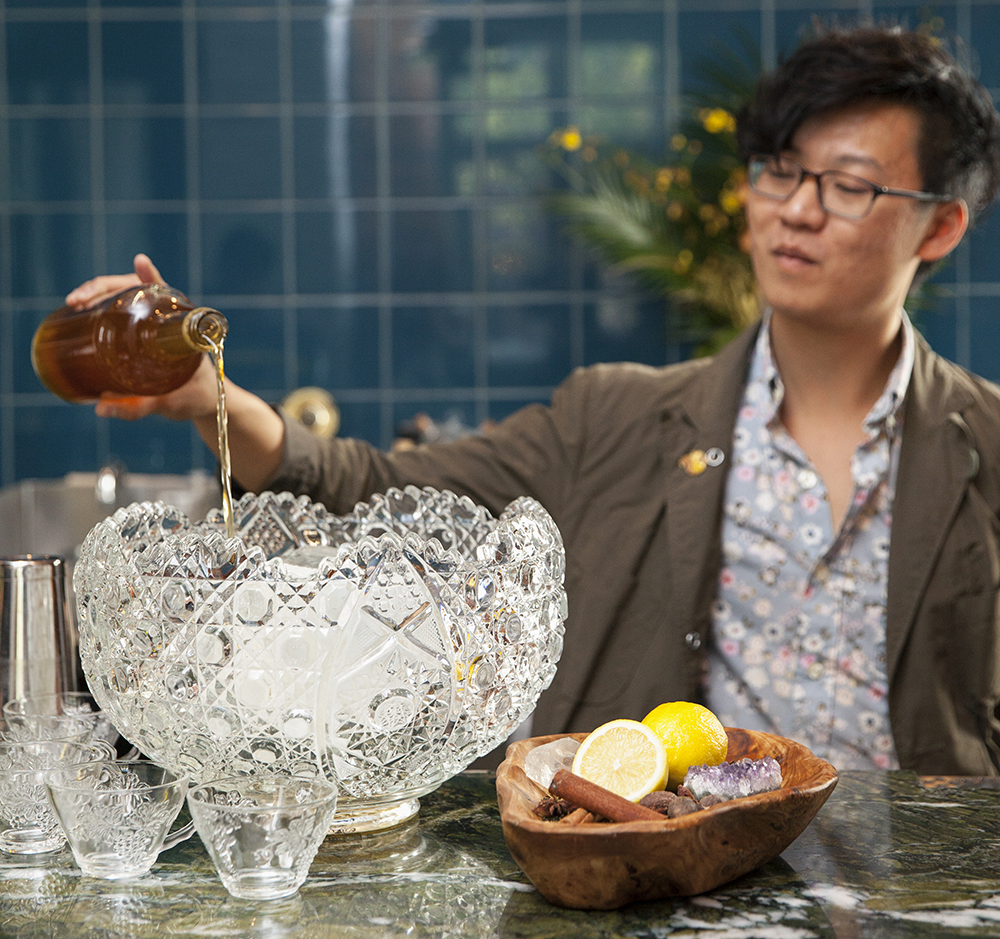 Dustin Nguyen adding his spirit base to the punch bowl // Photo by Katie Cannon