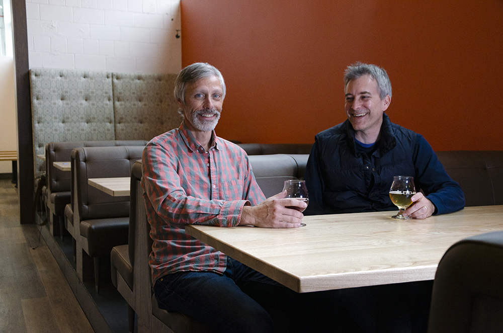 Colin Post, right, and Steve Hance sit inside their newly opened taproom in the North Loop of Minneapolis, Minnesota // Photo by Aaron Job