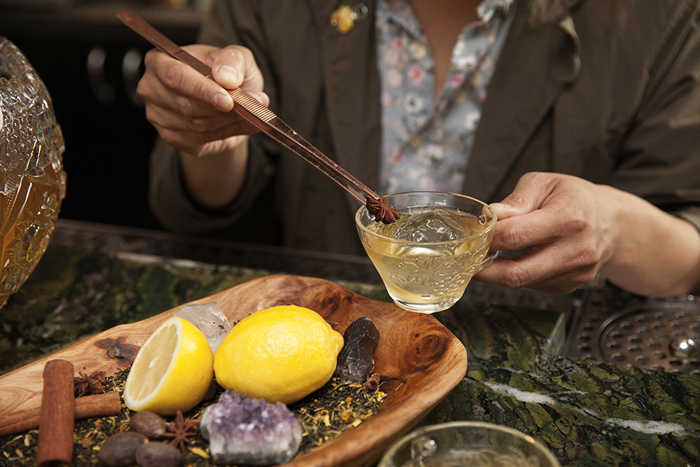 Dustin Nguyen tops his holiday punch with a star anise before serving // Photo by Katie Cannon