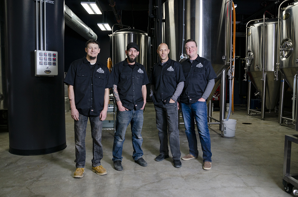 From left to right: Scott Wege, Andy Erickson, Ryan Keihn, and Brad Randall, the founders of Stacked Deck Brewing Company in St. Paul // Photo by Aaron Job