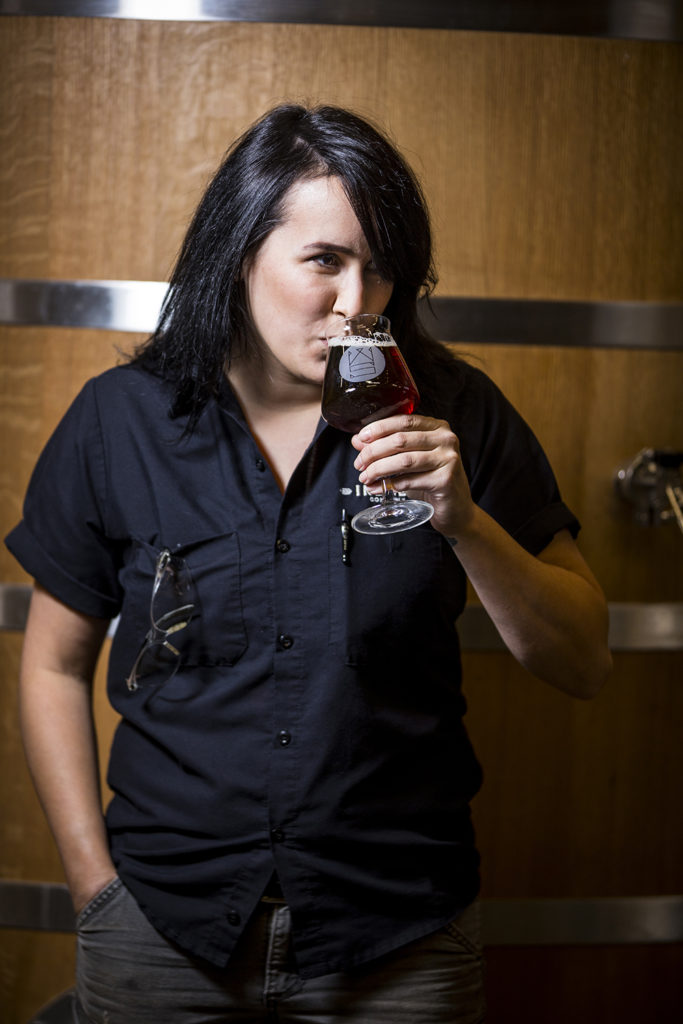 Indeed Brewing assistant brewer Tina Spurr enjoying a glass from the Wooden Soul barrel house // Photo by Tj Turner