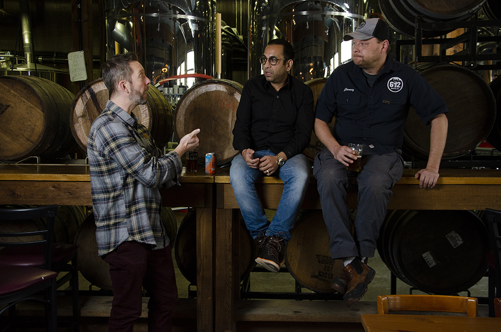 612Brew's Robert Kasak talking with business partners Aditya Kalra and Jamey Rossbach // Photo by Aaron Job