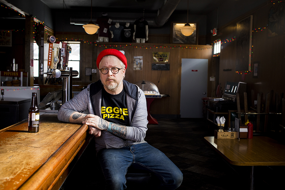 Doug Flicker sitting at the bar of Bull's Horn in South Minneapolis // Photo by Tj Turner
