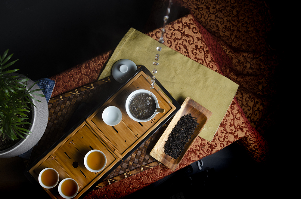 Hot water being poured over tea leaves and traveling tea set // Photo by Aaron Job