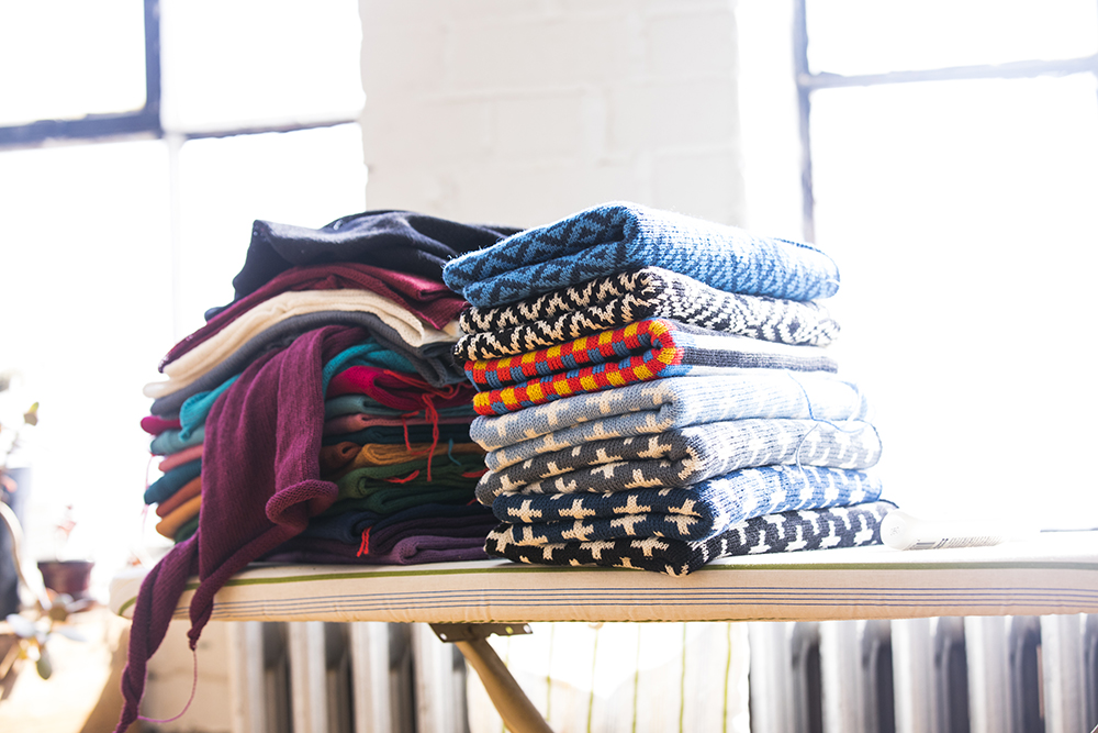A pile of the knitwear goods Thompson has made in Makwa Studio // Photo by Tj Turner